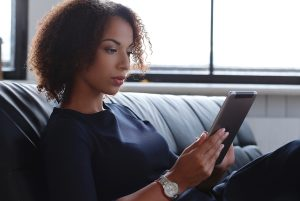Woman studying tablet